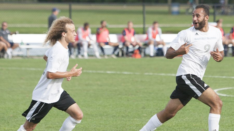 Dillan Schorfheide | The Daily Eastern News  Cameron Behm (left) and Shady Omar (right) celebrate Omar's goal by running toward the bleachers. Omar's goal, in the second half, tied Eastern's match against Belmont at 2-2 Tuesday at Lakeside Field.