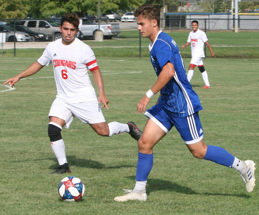 Karina Delgado | The Daily Eastern News Chrisitan Sosnowski dribbles the ball as a defender guards him. Eastern defeated St. Xavier 2-0 Tuesday at Lakeside Field in the team's season opener.