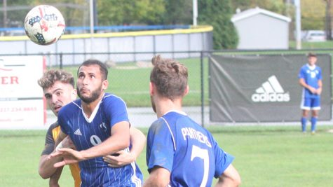 File Photo | The Daily Eastern News Shady Omar tries to retrieve the ball out of midair as a defender grabs him during the Eastern men's soccer team's 2-1 loss to Valparaiso in October 2018 at Lakeside Field.