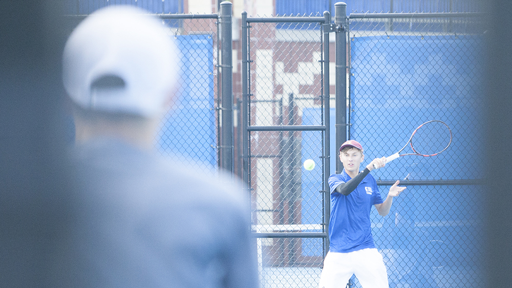Dillan Schorfheide | The Daily Eastern News Max Pilipovic-Kljajic returns the ball to his opponents' side of the court with a forehand hit. He competed in flight 1 for the men's singles matches in the Eastern Illinois Fall Invite Sept. 20 and 21 at the Darling Courts.