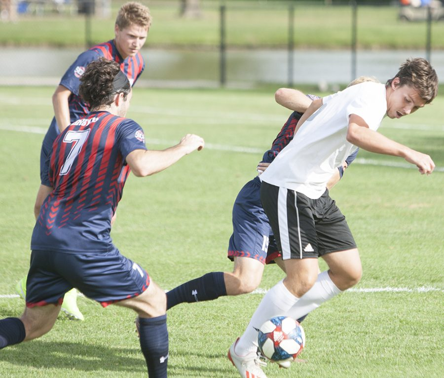 Dillan Schorfheide | The Daily Eastern News Junior Davi Giradi takes on one defender while two are lurking in the Panthers 3-2 double overtime win against Belmont on Sept. 24th at Lakeside Field.