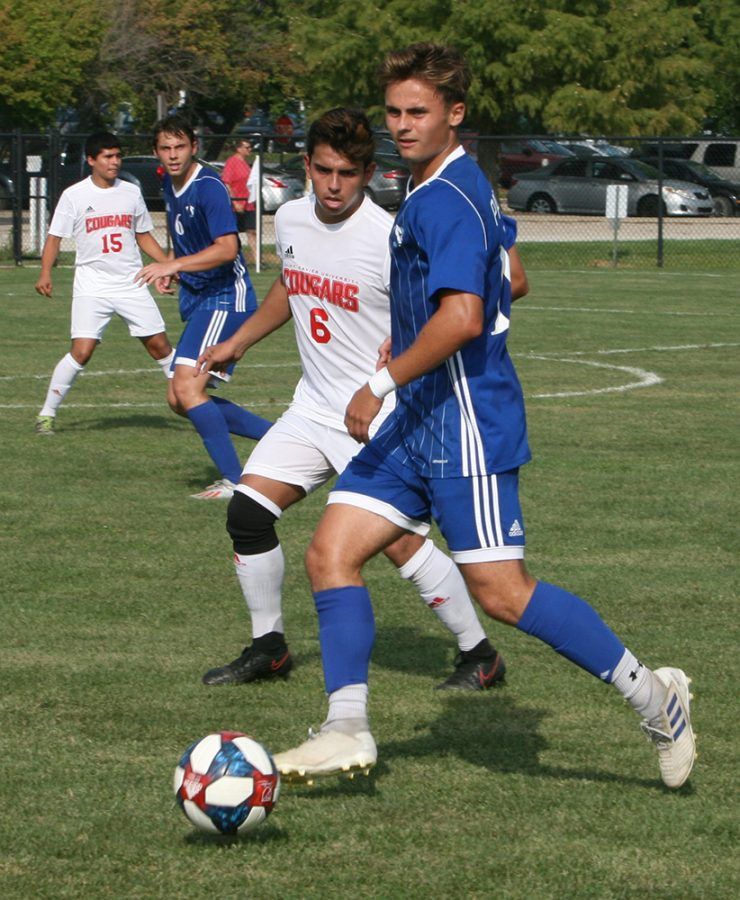 Karina Delgado | The Daily Eastern News  Eastern redshirt senior Christian Sosnowski controlls the ball while a Saint Xavier defender approaches in the Panthers 2-0 win at Lakeside Field on Sept. 10th. Sosnowski has one goal so far on the season, scoring against Ohio State on Sept. 8.