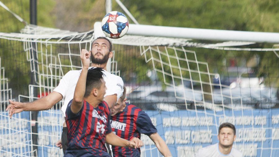 Dillan Schorfheide | The Daily Eastern News  Shady Omar attempts a headed shot off a throw in in Eastern's 3-2 win against Belmont Sept. 24 at Lakeside Field.