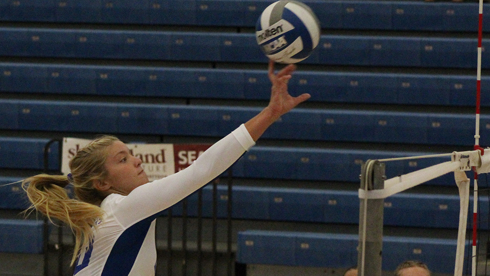 Adam Tumino | The Daily Eastern News Katie Sommer tries to tip the volleyball over the net for an Eastern point. Eastern lost 3-1 against Drake Aug. 31 in Lantz Arena during the EIU Panther Invitational.