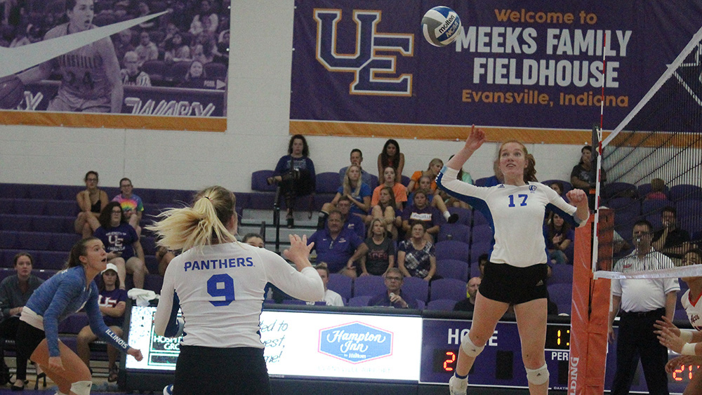 Adam Tumino | The Daily Eastern News Eastern sophomore Hannah Sieg (17) goes up to kill a set from Bailey Chandler (9) in the Panthers' 3-2 loss to Evansville on Sept. 14. Sieg had 9.5 points in the match.