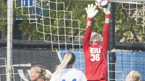 Dillan Schorfheide | The Daily Eastern News Sara Teteak rises up in front of the goal to bat away a crossed ball. Eastern lost 1-0 to Eastern Kentucky Sept. 27 at Lakeide Field.