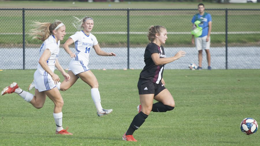 Dillan Schorfheide | The Daily Eastern News Lindsey Carlson (left) and Victoria Wharton (middle) frantically chase down an Eastern Kentucky forward who is on a breakaway. Eastern lost 1-0 to Eastern Kentucky Sept. 27 at Lakeside Field.
