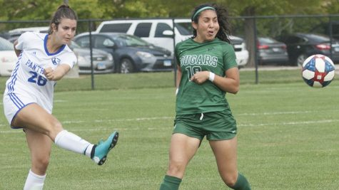 Karina Delgado | The Daily Eastern News Rachel Pappas boots the ball up the field as a defender runs up on her during Eastern's 3-1 victory over Chicago State Sept. 15 at Lakeside Field. That match was the first time this season Pappas was able to play a whole 90 minutes.
