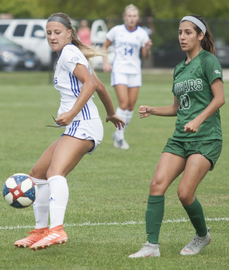 Karina Delgado | The Daily Eastern News Kenzie Balcerak fends off a defender to gain possession of the ball. Eastern won its first game of the season Sunday against Chicago State 3-1.