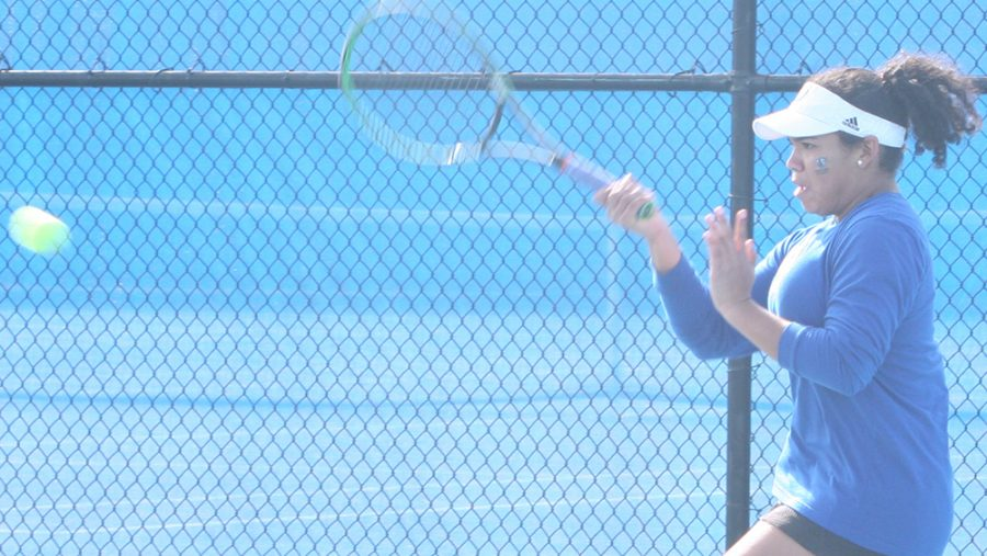 File Photo | The Daily Eastern News Karla Contreras returns a hit with a forehand hit of her own in a doubles match. Eastern lost 4-3 to Jacksonville State in March at the Darling Courts.