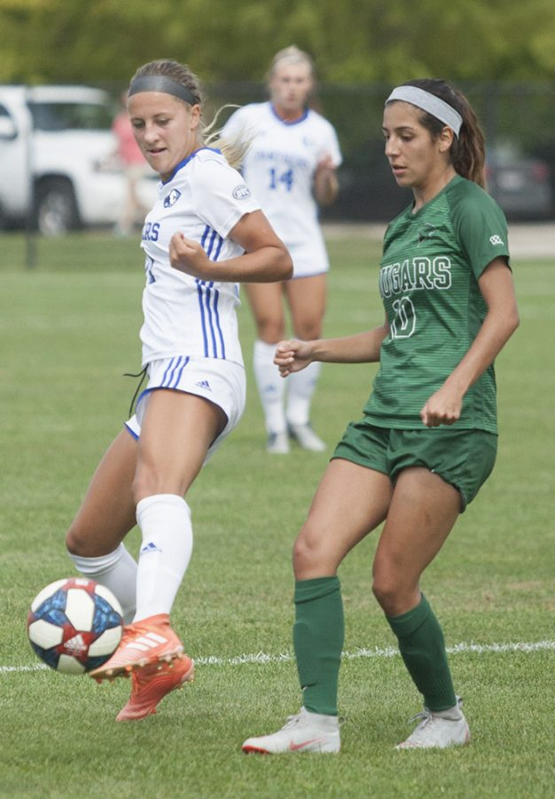 Karina Delgado | The Daily Eastern News Eastern's Kenzie Balcerak keeps the ball away from a Chicago State defender on Sept. 15 at Lakeside Field. Balcerak had an assist in the match, a 3-1 Panther win.