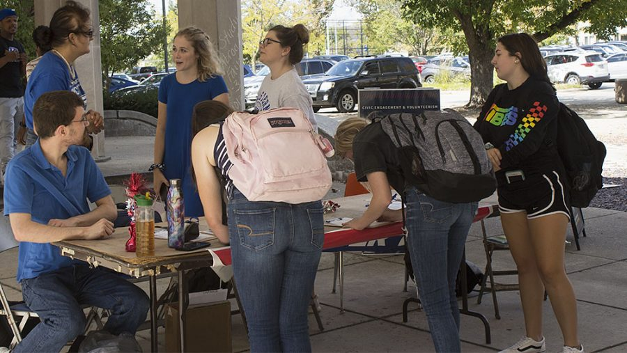 Students sign up for early voter registration outside of Coleman Hall on Tuesday afternoon.