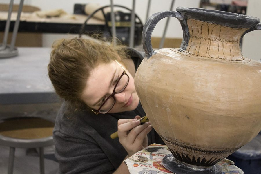 Josie Parish, a theater arts major, works in the lab to finish up some details for a pottery project for a class on Sunday afternoon in the Doudna Fine Arts Center.