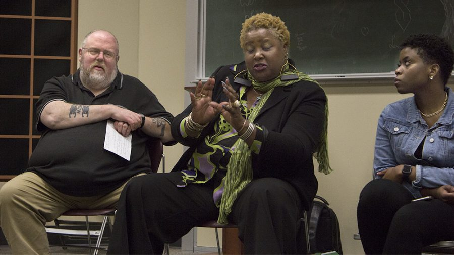 Jim Howler (left), a director of the B.A. in general studies degree program, and Morgan Howard (right), a public relations major, listen to Carole Collins Ayanlaja (middle), an assistant professor of educational leadership, as she discussed Rachel Dolezal, someone who posed as a black woman, during theRISE Chat: Race and Our Society on Monday night in Buzzard Hall's Auditorium.
