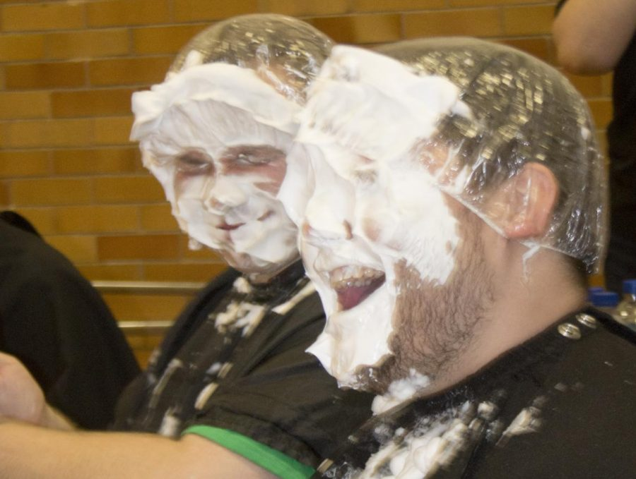 Joshua+Grostlin+%28front%29%2C+a+college+student+affairs+graduate+student%2C+and+Kurt+Ness+%28behind%29%2C+a+college+student+affairs+graduate+student%2C+get+pied+in+a+face+during+the+Rush+Hour+event+for+homecoming+week.