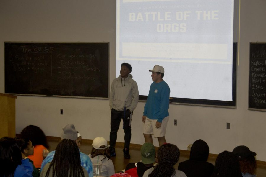 """Karl Webber (left), a junior political science major, and Cristian Melgoza (right), a junior corporate communication major,  participate in """"Battle of the Orgs"""" on Wednesday evening in the Coleman Auditorium. Webber and Melgoza are part of Sigma Phi Epsilon and had to spell out words as part of the battle."""