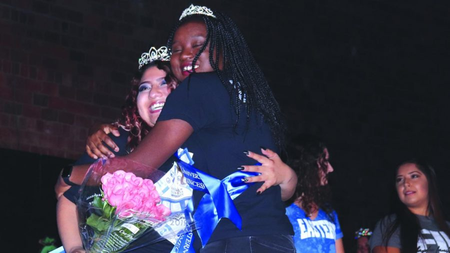 Samira Abdoulaye-Pedila, the 2018 homecoming princess, hugs Diana Argueta as she is crowned Easterns homecoming princess during coronation and the pep rally in McAfee Gym Oct. 24, 2019.