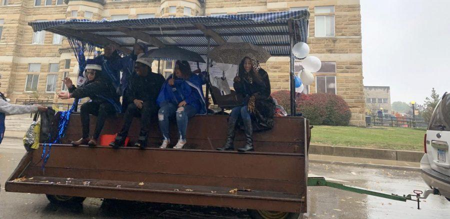 Members of Eastern's homecoming court wave from their float during the homecoming parade on Saturday. Homecoming King is Isaiah McClaine, Queen is Brittany Britton, Prince is Chateau Fouchea and Princess is Diana Argueta.
