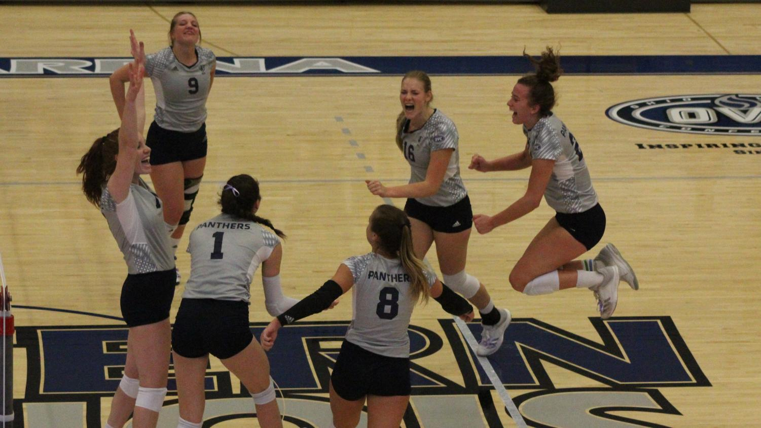 The Eastern volleyball team celebrates a 39-37 win in the first set against Tennessee Tech on Oct. 18. The Panthers won the match in five sets, earning their first conference win of the season.