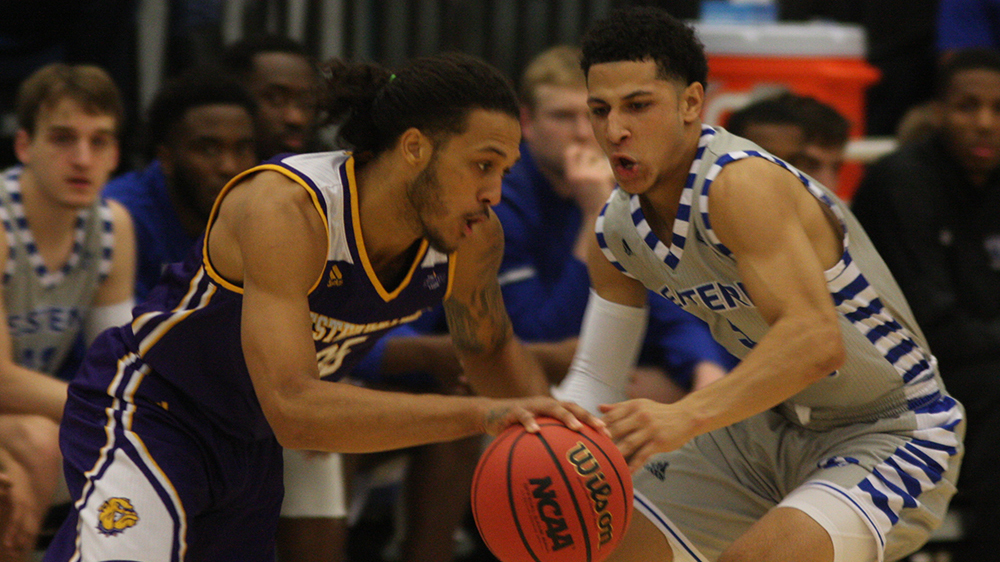 Eastern guard Shareef Smith guards a Western Illinois player in Lantz Arena last November. Smith had 12 points in the game, which the Panthers won 68-66 in overtime.