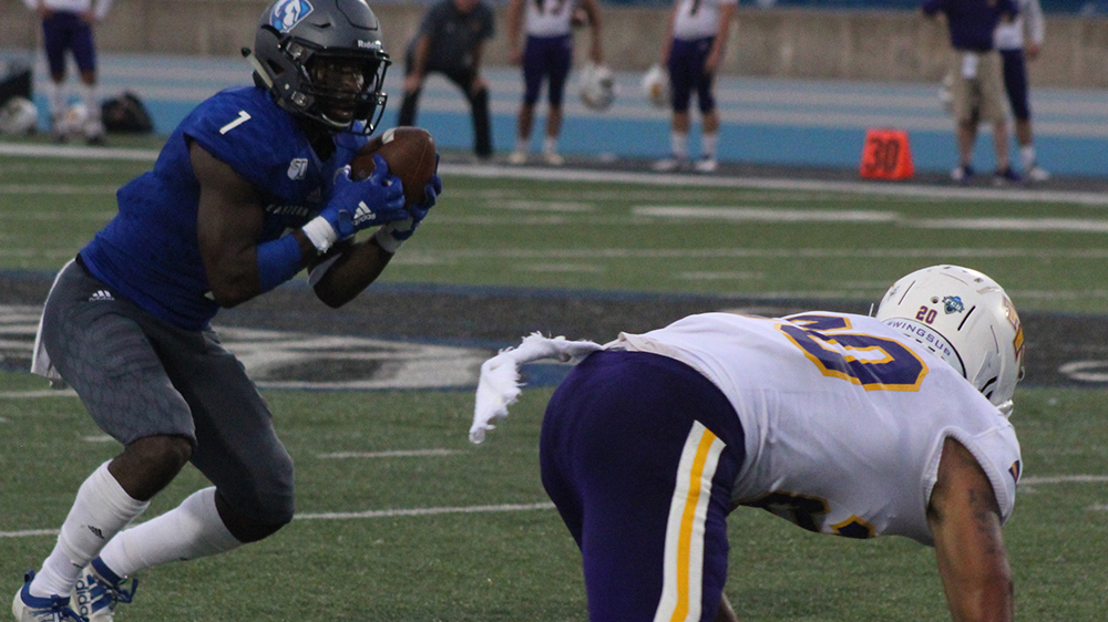 Adam Tumino | The Daily Eastern News Isaiah Hill catches a short pass and gets ready to try to avoid an oncoming tackler. Eastern lost 40-29 to Tennessee Tech Sept. 28 at O'Brien Field.