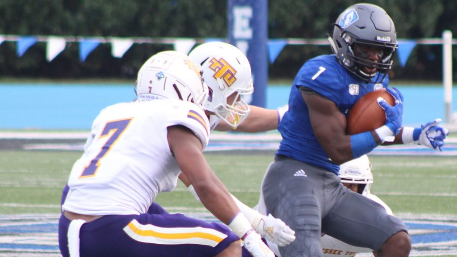 Adam Tumino | The Daily Eastern News Isaiah Hill tries to avoid being brought down by three defenders. Eastern lost 40-29 to Tennessee Tech Sept. 28 at O'Brien Field.