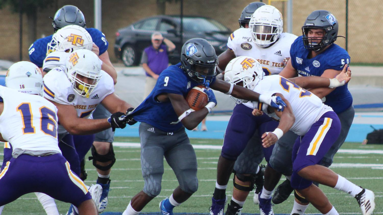 Eastern running back Jaelin Benefield attempts to escape the grasp of a Tennessee Tech defender on Sept. 28 at O'Brien Field. Benefield had 69 receiving yards, 46 rushing yards and two rushing touchdowns in the Panthers' 40-29 loss to the Golden Eagles.
