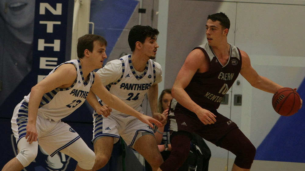 File Photo | The Daily Eastern News Ben Harvey (left) and Rade Kukobat (middle) defend Nick Mayo as he backs down in the post, along the baseline. Eastern defeated Eastern Kentucky 67-66 Jan. 31 in Lantz Arena.
