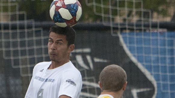 Matheus Santos tries to head a ball past a defender, who is looking on. Eastern lost 2-0 to Milwaukee Tuesday at Lakeside Field.