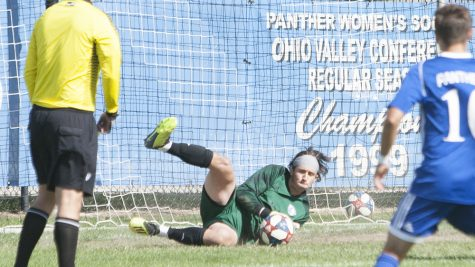 Dillan Schorfheide | The Daily Eastern News Jonathan Burke makes a diving save off a rebound shot, coming after making an initial save on a penalty kick. Eastern tied Omaha 0-0 Oct. 19 at Lakeside Field.