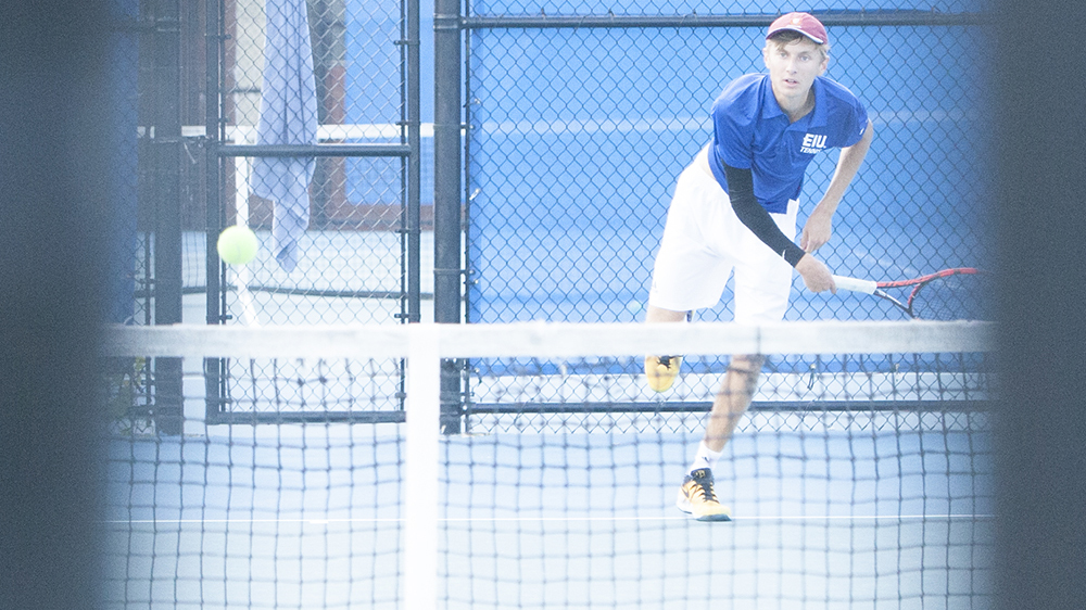 Dillan Schorfheide | The Daily Eastern News Max Pilipovic-Kljajic nails a serve to his opponent and completes his follow-through. Pilipovic-Kljajic competed in the Eastern Illinois Fall Invite Sept. 20 and 21 at the Darling Courts.