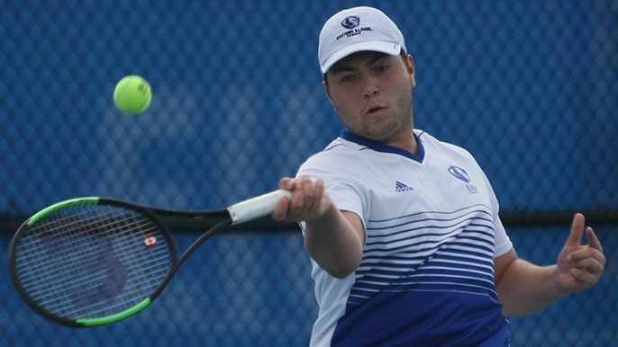 File Photo | The Daily Eastern News Gage Kingsmith returns a hit with a forehand strike of his own. Eastern lost to Jacksonville State 6-1 at the Darling Courts in March.