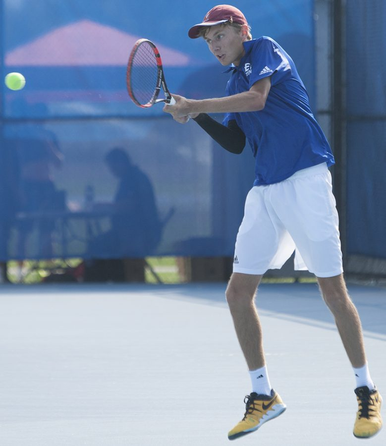 Dillan Schorfheide | The Daily Eastern News Freshman Max Pilipovic-Kljajic hits a backhand shot during the Eastern Illinois Fall Invite Sept. 20 and Sept. 21 at the Darling Courts.