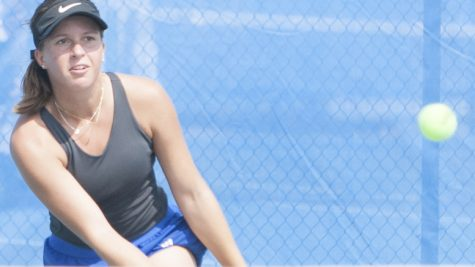 Dillan Schorfheide | The Daily Eastern News Elizaveta Bukraba-Ulanova slices a return hit to her opponent. Bukraba-Ulanova competed at the Eastern Illinois Fall Invite, which lasted Sept. 20 to Sept. 21 at the Darling Courts.