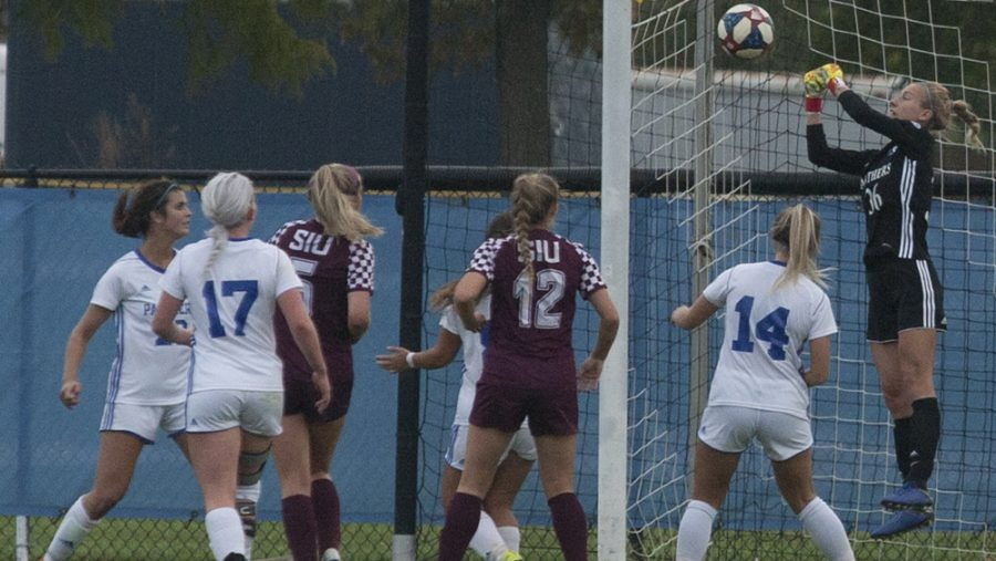 Dillan Schorfheide | The Daily Eastern News Sara Teteak rises up and punches a cross away among a sea of players. Eastern tied 0-0 with Southern Illinois Oct. 10 at Lakeside Field.