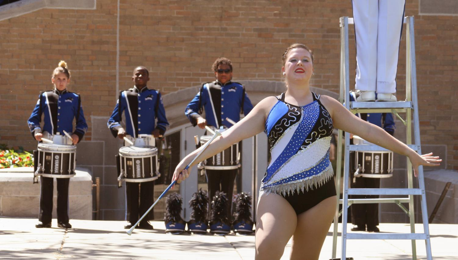Cassie McCleery, a senior majoring in family consumer science with a focus in education, twirls during a Library Quad performance before a September football game.