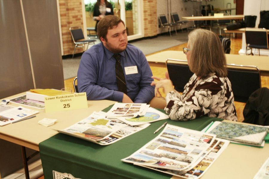 Blake Esker, a middle level education major senior, talks to a recruiter during the teacher job fair on Wednesday. Esker is interested on what the fair had to offer and enjoyed the amount of options the job fair had to offer.