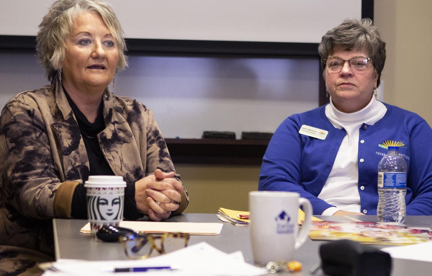 """Sheila Greuel (right), a geriatric services manager, listens as Michelle Matteson, a hospice manager and death doula worker, as she discusses what death doulas do and her own experiences as a death doula during """"Death Doulas: End of Life Role"""" at Blair Hall Thursday morning. Matteson said death doulas help fill in for hospice workers since hospice may not have time for too many questions. Death doulas also help support the family and patient emotionally."""