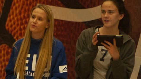 Adam Tumino | The Daily Eastern News Eastern freshmen Kristen Jankowski (left) and Mackenzie Duvall keep stats from the sideline during the Panthers' five-set win against Chicago State Nov. 11 in Lantz Arena.