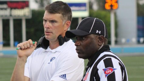 Eastern head coach Adam Cushing talks with the line judge during an official review in the Panthers' game against Tennessee Tech last September.