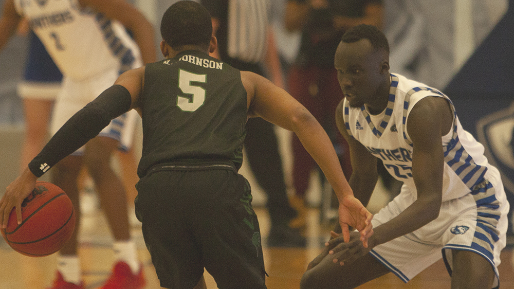 Adam Tumino | The Daily Eastern News Deang Deang defends Chicago State's Xavier Johnson as Johnson brings the ball up the court. Deang led Eastern with 21 points in the Panthers' 98-34 victory in Lantz Arena Tuesday.