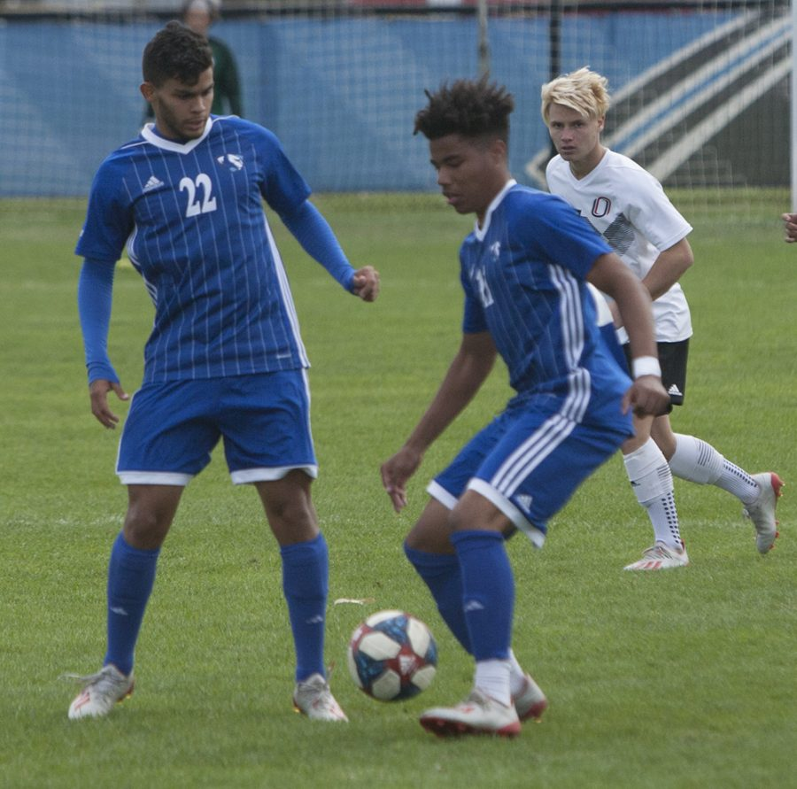 Jonas Castelhano (left) and Cole Stephens (middle) decide who's going to attack in Eastern's 0-0 double overtime tie against Omaha on Oct. 19th at Lakeside Field.