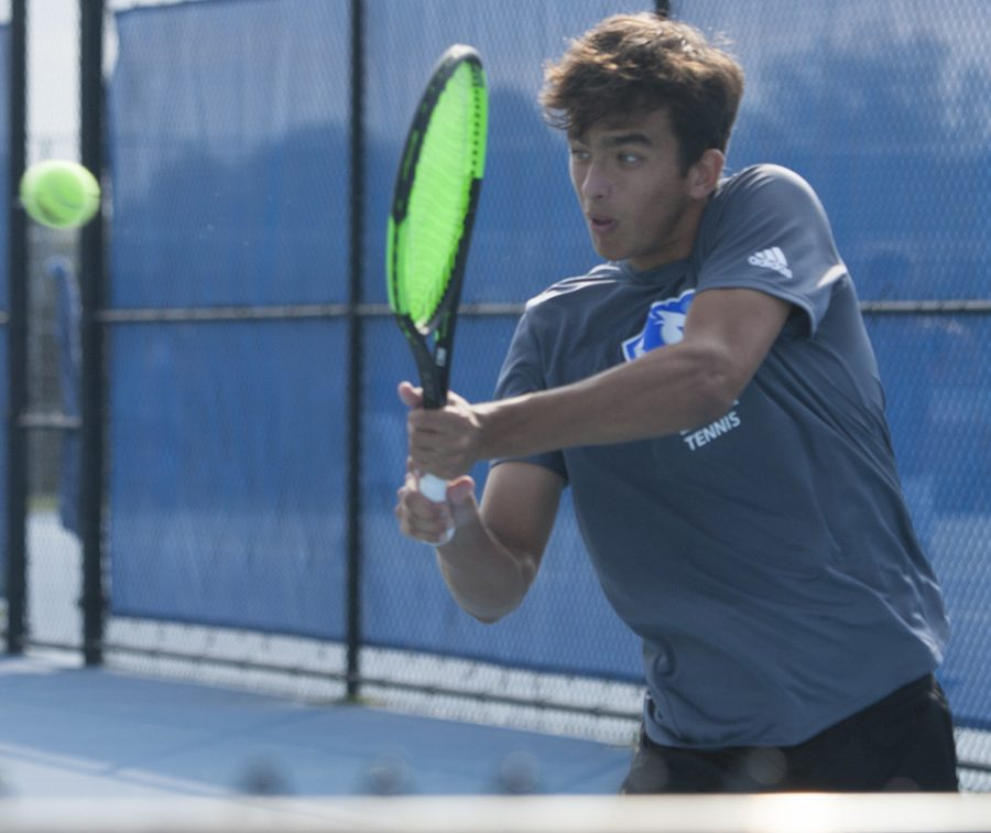 Dillan Schorfheide | The Daily Eastern News Freshman Pau Riera attempts a forehand hit at the Eastern Illinois Fall Invite om Sept. 20 at Darlings Courts.