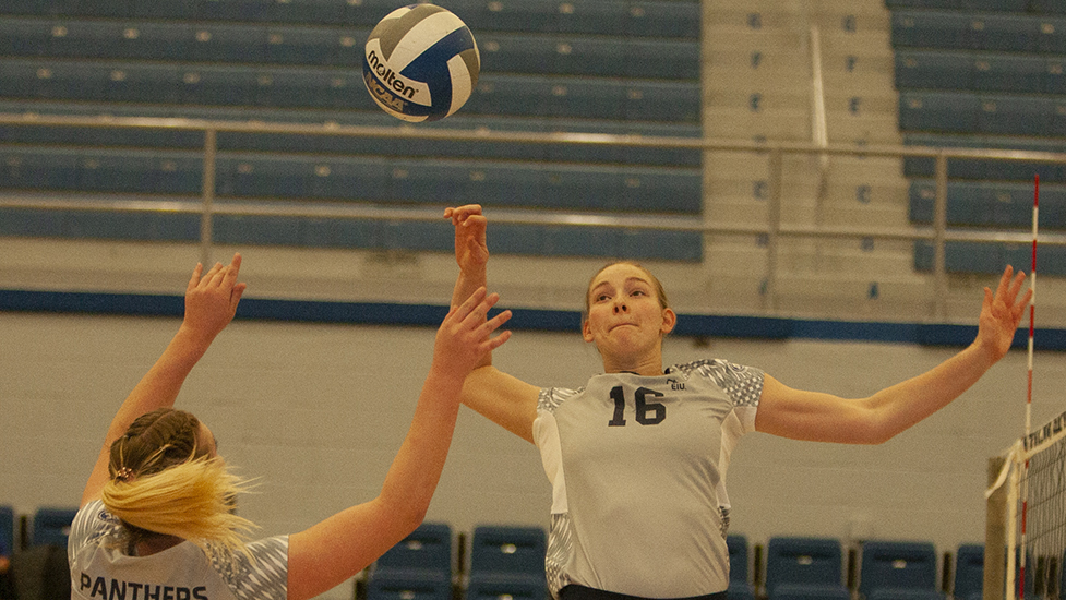Eastern senior Maggie Runge jumps to kill a set from Bailey Chandler in the Panthers' five-set win over Chicago State Nov. 11 in Lantz Arena. Runge's .571 hitting percentage in the match led all players and her 17 kills tied for the second-most on the team.