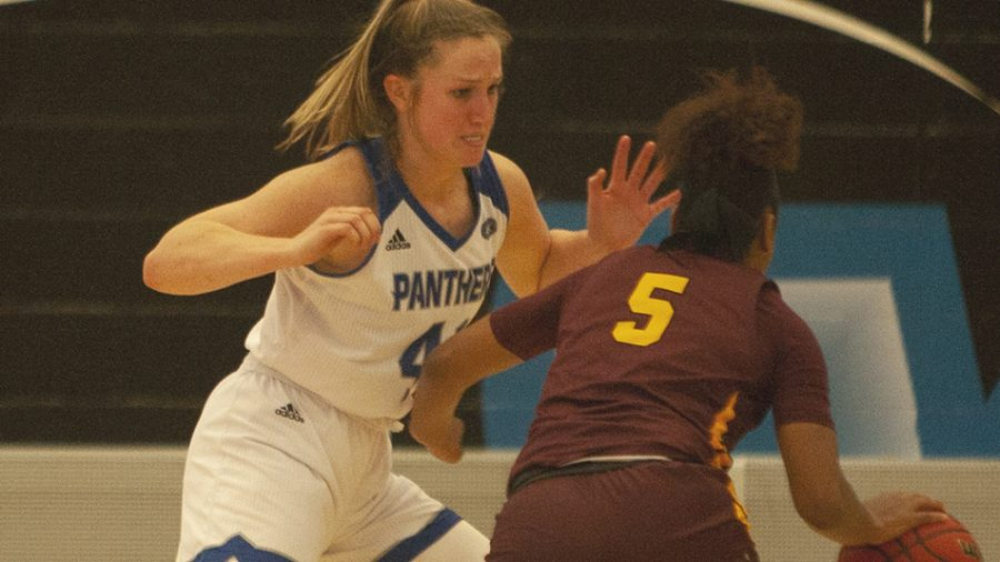 Dillan Schorfheide | The Daily Eastern News Abby Wahl guards Loyola-Chicago's Tiara Wallace as Wallace dribbles along the wing. Wahl finished with four points in Eastern's 67-51 loss Wednesday in Lantz Arena.
