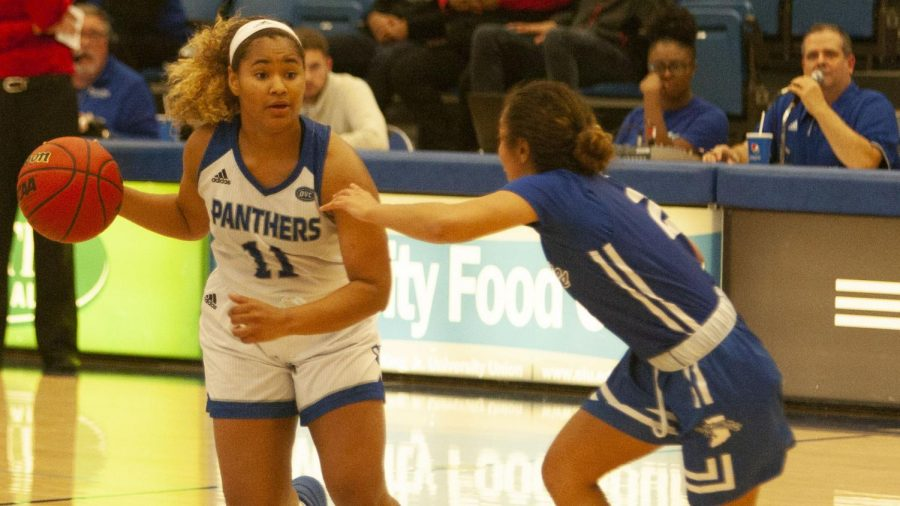 Eastern guard Karle Pace handles the ball near the top of the key against Indiana State Nov. 10 in Lantz Arena. Pace had 20 points and five assists in the game, which the Panthers lost 59-57.