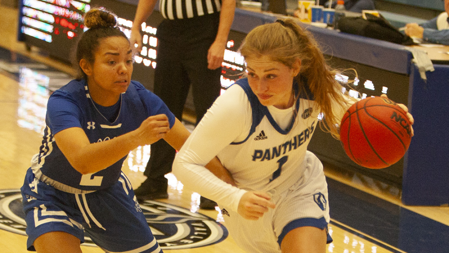 Eastern+guard+Kira+Arthofer+drives+around+a+defender+against+Indiana+State+Sunday+in+Lantz+Arena.+The+Panthers+lost+to+the+Sycamores+59-57.
