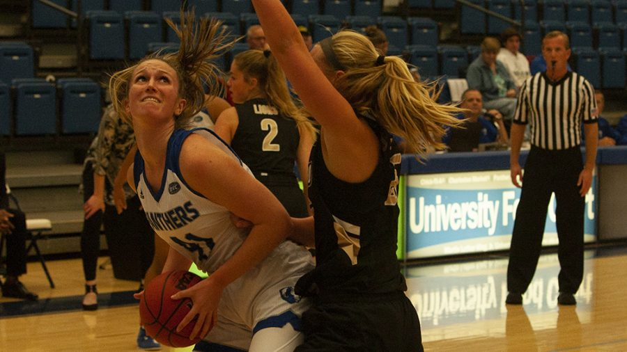 Eastern+forward+Abby+Wahl+fights+through+contact+under+the+basket+against+Lindenwood+on+Nov.+5+in+Lantz+Arena.+Wahl+had+17+points+in+a+88-66+win+for+the+Panthers.+