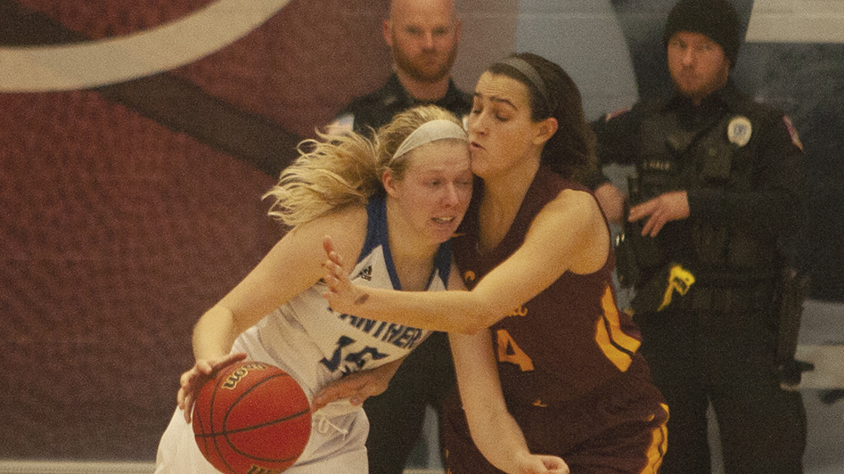 Dillan Schorfheide | The Daily Eastern News Taylor Steele tries to drive inside against a defender. Eastern lost 67-51 against Loyola-Chicago Nov. 13 in Lantz Arena.