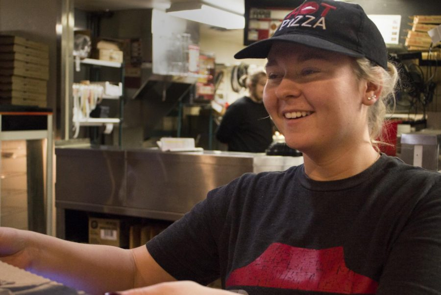 Mylissa+Greenawalt%2C+a+sophomore+special+education+major%2C+gives+two+customers+their+pizza+at+Charleston%E2%80%99s+Pizza+Hut+Sunday+afternoon.+Greenawalt+said+she+stayed+in+Charleston+during+Thanksgiving+break+to+work+at+Pizza+Hut.+
